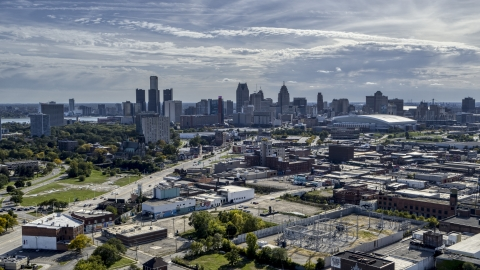 DXP002_195_0001 - Aerial stock photo of The city's skyline seen from brick industrial buildings, Downtown Detroit, Michigan