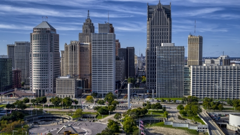 DXP002_196_0001 - Aerial stock photo of Towering skyscrapers across from Hart Plaza, Downtown Detroit, Michigan