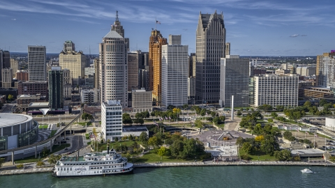 DXP002_196_0005 - Aerial stock photo of Tall skyscrapers and Hart Plaza, Downtown Detroit, Michigan