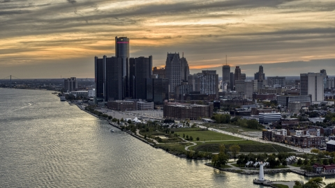 DXP002_197_0005 - Aerial stock photo of The GM Renaissance Center and the city's skyline seen from river at sunset, Downtown Detroit, Michigan