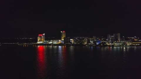 DXP002_199_0001 - Aerial stock photo of A view of Caesars Windsor hotel and casino across the river at nighttime, Windsor, Ontario, Canada