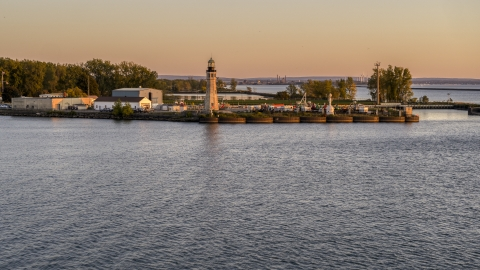 DXP002_204_0009 - Aerial stock photo of The Lake Erie lighthouse at sunset, Buffalo, New York