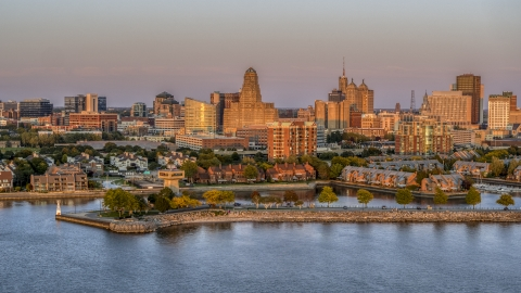 DXP002_204_0012 - Aerial stock photo of City hall and office buildings at sunset, seen from waterfront condos, Downtown Buffalo, New York