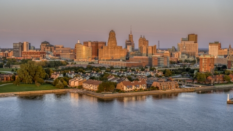 DXP002_204_0013 - Aerial stock photo of A view of city hall and office buildings at sunset, seen from waterfront condos, Downtown Buffalo, New York