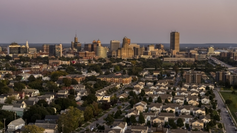 DXP002_204_0015 - Aerial stock photo of A wide view of the city's skyline at twilight, Downtown Buffalo, New York