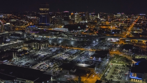DXP002_205_0002 - Aerial stock photo of The skyline at night seen from arena parking lots, Downtown Buffalo, New York