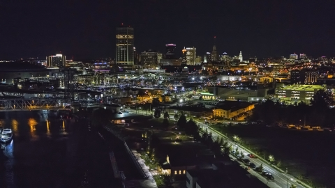 DXP002_205_0003 - Aerial stock photo of The skyline seen from the river at night, Downtown Buffalo, New York