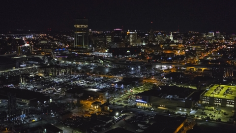 DXP002_205_0004 - Aerial stock photo of The skyline near arena parking lots at night, Downtown Buffalo, New York