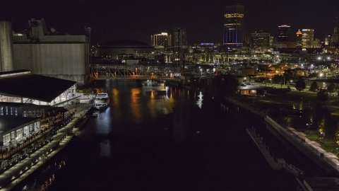 DXP002_205_0005 - Aerial stock photo of The river toward the downtown skyline at night, Downtown Buffalo, New York
