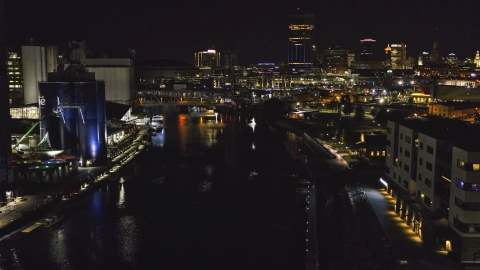 DXP002_205_0006 - Aerial stock photo of A view of the river toward the downtown skyline at night, Downtown Buffalo, New York