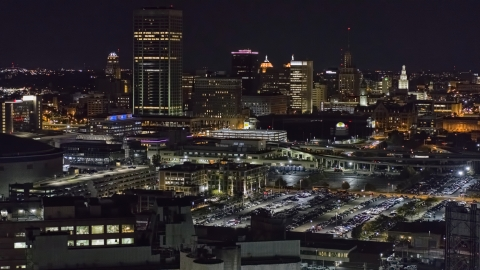 DXP002_205_0007 - Aerial stock photo of The skyline seen from parking lots at night, Downtown Buffalo, New York
