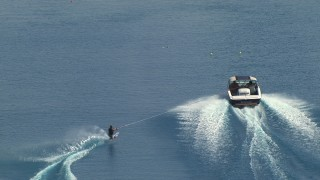 AF0001_000015 - HD stock footage aerial video of tracking a woman water skiing behind a boat, Central Valley, California