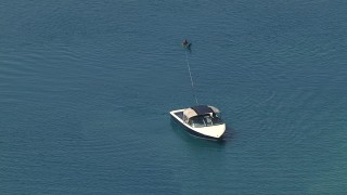 AF0001_000017 - HD stock footage aerial video of a waterskier just before the boat takes off, Central Valley, California