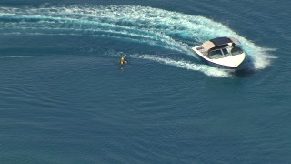 AF0001_000018 - HD aerial stock footage video of tracking a boat getting into position for a waterskier, Central Valley, California