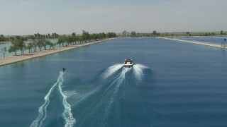 AF0001_000021 - HD stock footage aerial video of tracking a woman waterskiing behind a boat in the Central Valley, California