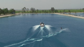 AF0001_000022 - HD stock footage aerial video track woman waterskiing on a lakeCentral Valley, California