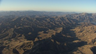 AF0001_000023 - Aerial stock footage of Flying by mountains revealing Quail Lake, Transverse Ranges, California