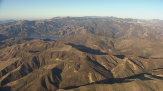 AF0001_000024 - Aerial stock footage of Flying by mountain ranges bordering Quail Lake, Transverse Ranges, California
