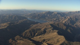 AF0001_000026 - Aerial stock footage of Flying by Quail Lake surrounded by Transverse Ranges mountain ridges, California