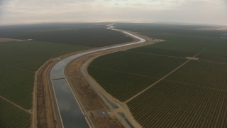 AF0001_000032 - HD stock footage aerial video of the California Aqueduct, winding through farmland, Central Valley, California