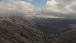 AF0001_000039 - HD stock footage aerial video fly over mountains by Interstate 5, low clouds, Tejon Pass, California