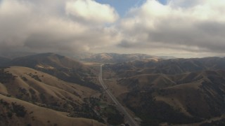 AF0001_000040 - HD stock footage aerial video of flying under low clouds to follow Interstate 5 through Tejon Pass, California
