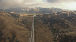 AF0001_000042 - HD stock footage aerial video tilt from Interstate 5 to reveal low clouds over Castaic Lake and Tejon Pass, California