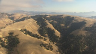 AF0001_000044 - HD stock footage aerial video fly over mountains to reveal Interstate 5, Tejon Pass, California