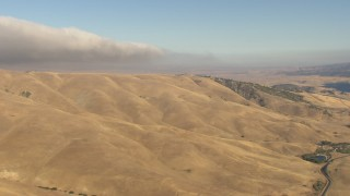 AF0001_000046 - HD stock footage aerial video of flying by hills to reveal Quail Lake and the California Aqueduct, Tejon Pass, California