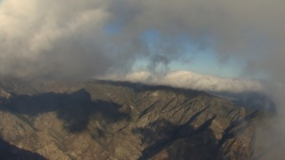 AF0001_000049 - Aerial stock footage of Fly beneath clouds to approach mountains, Transverse Ranges, California