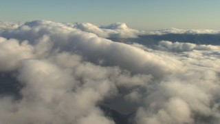 AF0001_000052 - Aerial stock footage of Passing low clouds above mountains, Transverse Ranges, California