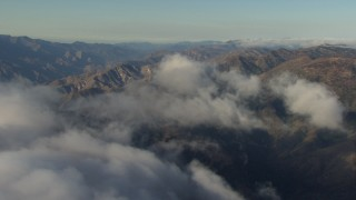 AF0001_000053 - Aerial stock footage of Passing low cloud cover and rugged mountains in the Transverse Ranges, California