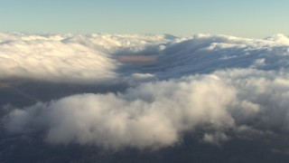 AF0001_000054 - Aerial stock footage of Thick cover of clouds hovering over mountains, Transverse Ranges, California