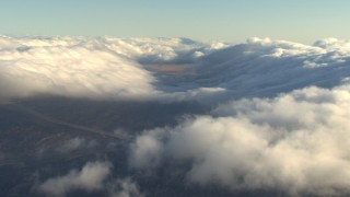 AF0001_000055 - Aerial stock footage of Passing clouds over the Transverse Ranges, California