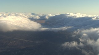 AF0001_000056 - Aerial stock footage of Cloud layers over the Transverse Ranges, California