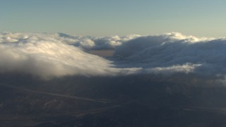AF0001_000057 - Aerial stock footage of Flying by low clouds covering mountains, Transverse Ranges, California