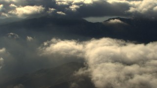 AF0001_000058 - Aerial stock footage of Reverse view of clouds and mountain ridge in the Transverse Ranges, California