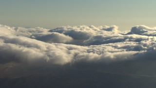 AF0001_000059 - Aerial stock footage of Clouds rolling over mountains, Transverse Ranges, California