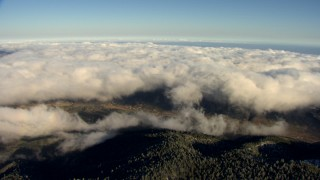 AF0001_000063 - Aerial stock footage of Approach a layer of clouds rolling over a small town in the Transverse Ranges, California