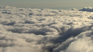 AF0001_000066 - Aerial stock footage of Passing dense cloud cover over the Central Valley, California