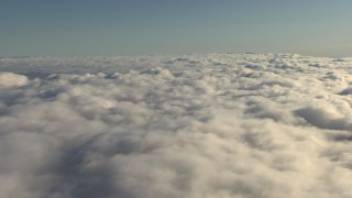 AF0001_000067 - HD stock footage aerial video of a wide layer of clouds over the Central Valley, California