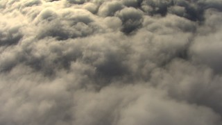 AF0001_000068 - Aerial stock footage of Reverse view of a layer of clouds in the Central Valley, California