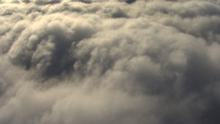 AF0001_000069 - Aerial stock footage of Reverse view of clouds covering the Central Valley, California