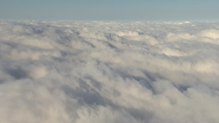 AF0001_000071 - Aerial stock footage of Flying by an expanse of low, thick clouds, Central Valley, California