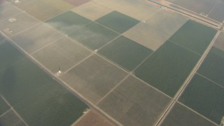 AF0001_000073 - Aerial stock footage of Bird's eye view of farmland, California Aqueduct, Central Valley, California