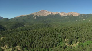 AF0001_000084 - HD stock footage aerial video tilt and fly over a mountain ridge to reveal Pikes Peak, Colorado
