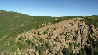 AF0001_000086 - HD stock footage aerial video flyby rocky slopes and trees in the Rocky Mountains, Colorado