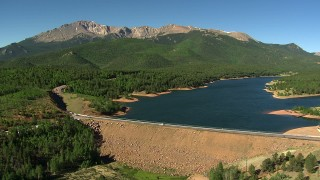 AF0001_000087 - HD stock footage aerial video tilt from the dam at Crystal Creek Reservoir to reveal Pikes Peak, Colorado