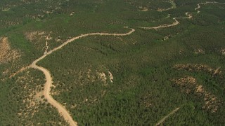 AF0001_000098 - HD stock footage aerial video tilt from a forest road to reveal South and North Catamount Reservoirs, Pikes Peak, Colorado