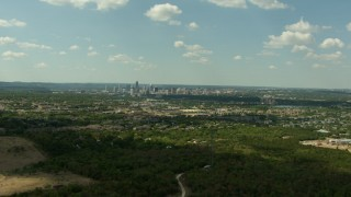 AF0001_000100 - HD stock footage aerial video approach apartment buildings with a view of the skyline of Downtown Austin, Texas